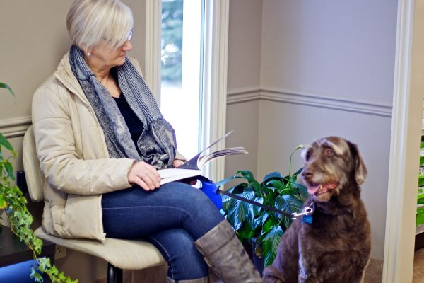 woman and dog in Waiting Room